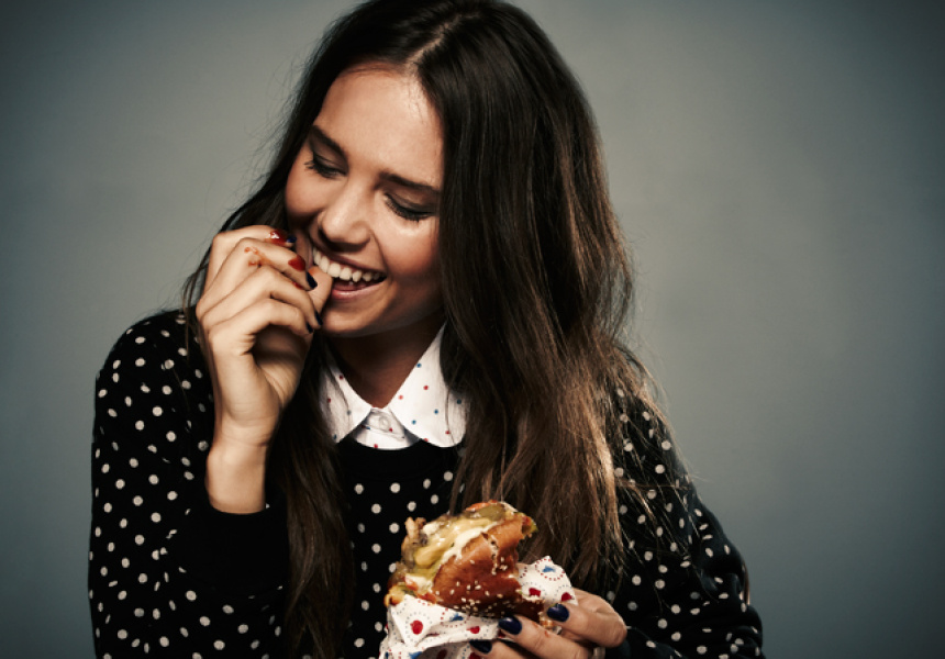 Jemma from Giant eating a Huxtaburger,