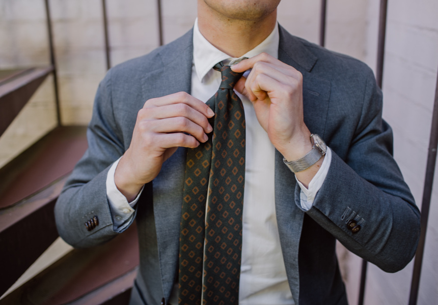 Always make sure your tie's nice and tight. Ties fall down if the knot isn't tight enough. (Silk tie by Rubinacci, jacket by P Johnson Tailors, shirt bespoke by Ascot Chang).