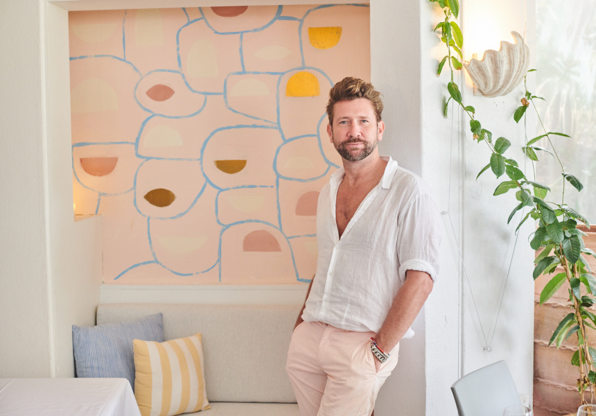Daimon Downey in front of his artwork at Rae's on Wategos in Byron Bay.