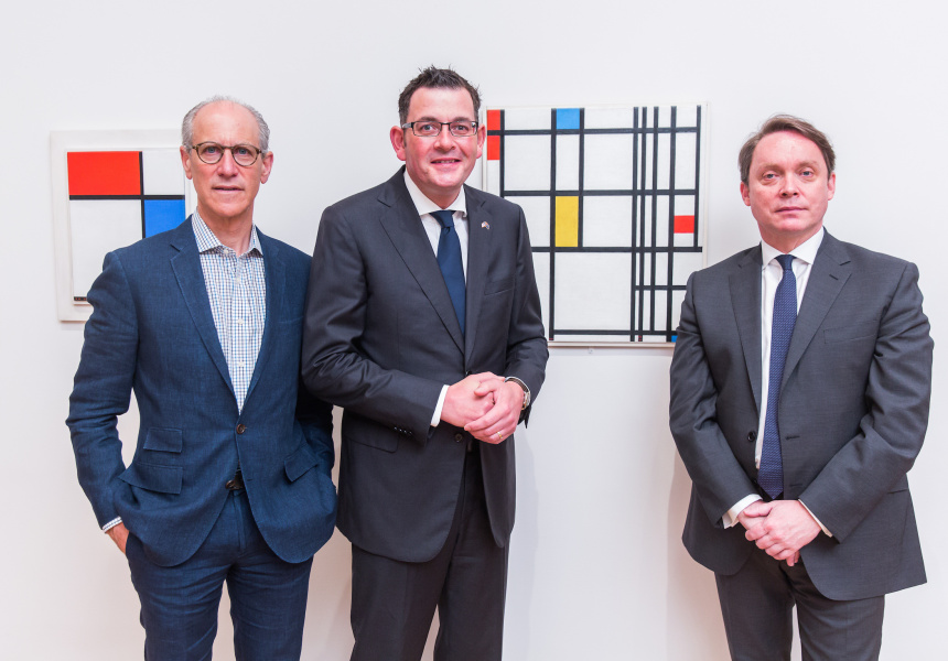 (Left to right) Glenn D. Lowry, Director, MoMA, The Hon. Premier Daniel Andrews and Tony Ellwood, Director, NGV in front of Piet Mondrian's Composition in Red, Blue, and Yellow, 1937-42.