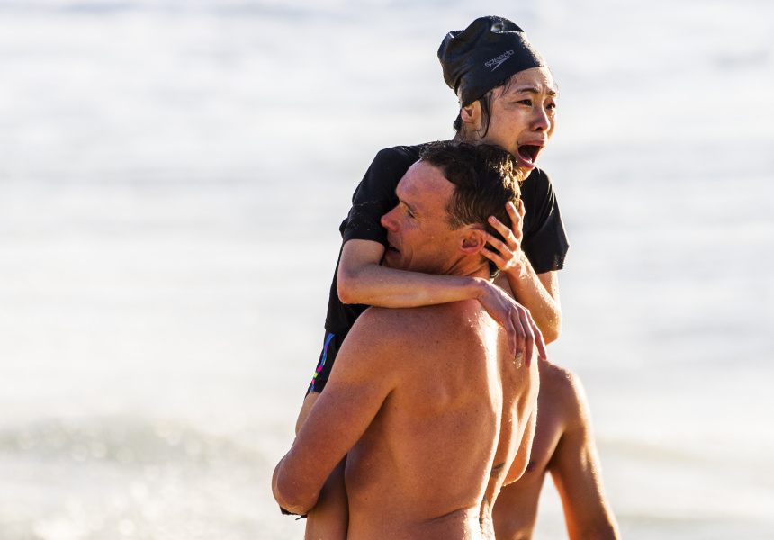 A distraught woman is assisted by a lifeguard after being rescued from the raging surf. The woman came dangerously close to drowning after being caught in a rip at Bronte Beach in Sydney.