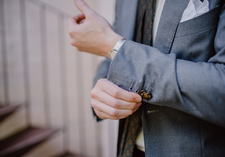 Undo a couple of buttons on your jacket cuff.