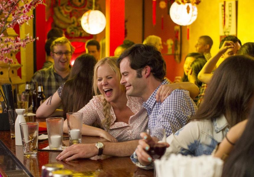 Amy Schumer (left) and Bill Hader (right) in Trainwreck