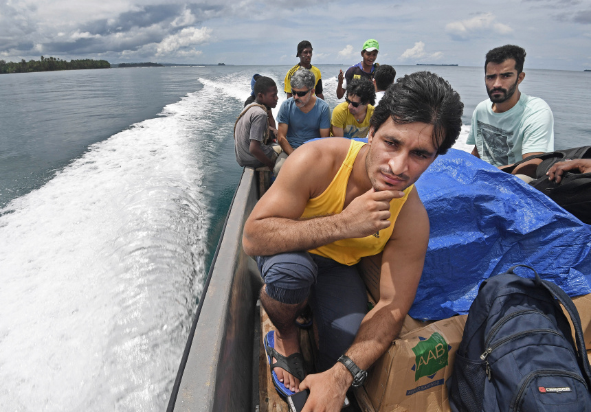 Asylum seekers (with Ezatullah Kakar from Pakistan - foreground) take urgently needed foods and medicines back to the Lombrum asylum seeker detention centre on Manus Island PNG on an illicit local boat run.
