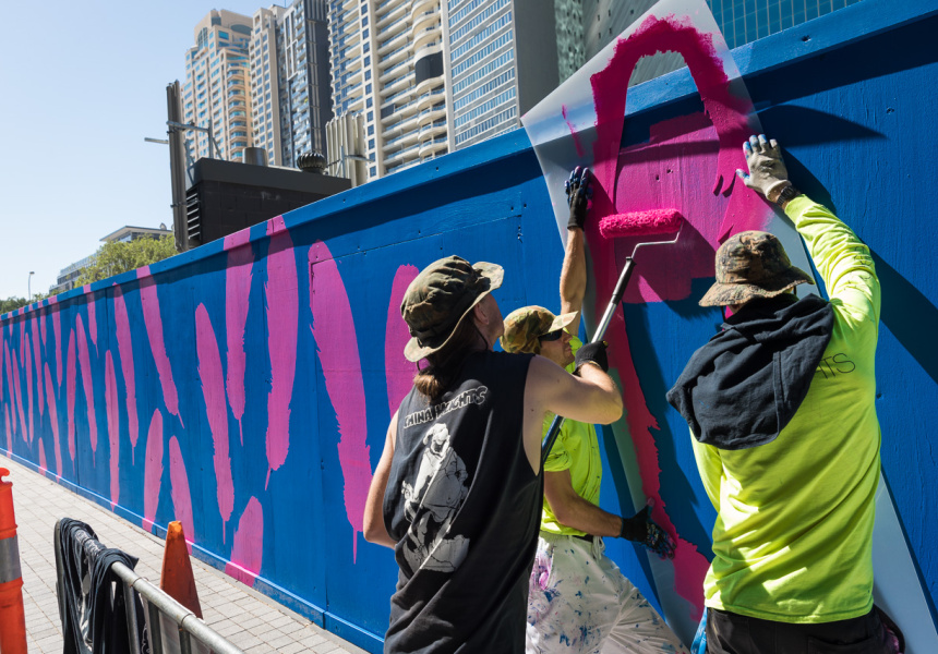 Reko Rennie on site with As The Crow Flies, his work in progress currently being painted at Barangaroo. Photo: Daniel Boud