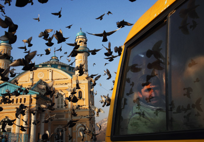 Pigeons take to the sky outside Shah e-Doh Shamshira Mosque in Kabul.