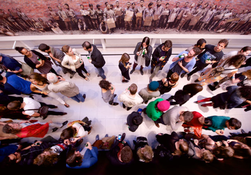 Crowd with Jin Feng's 10-metre-long photograph Appeals Without Words (2006)