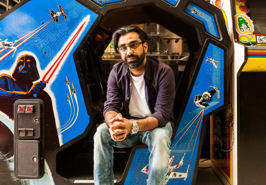 Saran Bajaj with one of the vintage arcade games in his personal collection.
