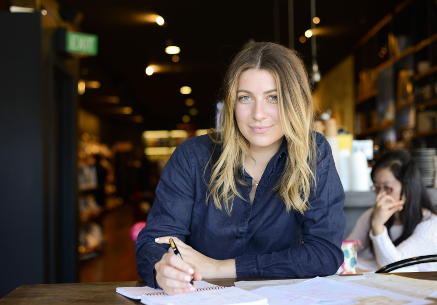 Bianca Isgro working on her shortlisted design from her preferred workspace in Berkelouw Books in Paddington, Sydney.