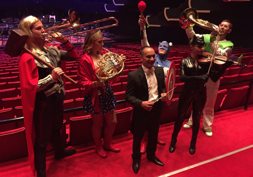Conductor Chris Dragon surrounded by members of WASO.