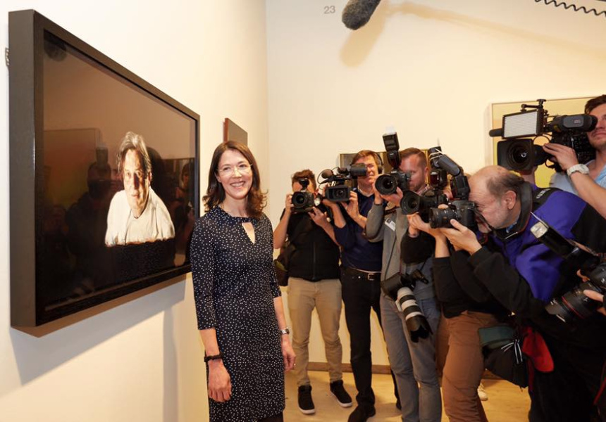 Winner of the Archibald Prize 2016, Louise Hearman, in front of her winning portrait