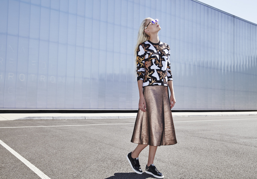 Sweater by Kenzo at Myer. Skirt by Zimmermann. Sunglasses by Karen Walker. Rings by 32.4. Sneakers by Nike at Platypus Shoes.
