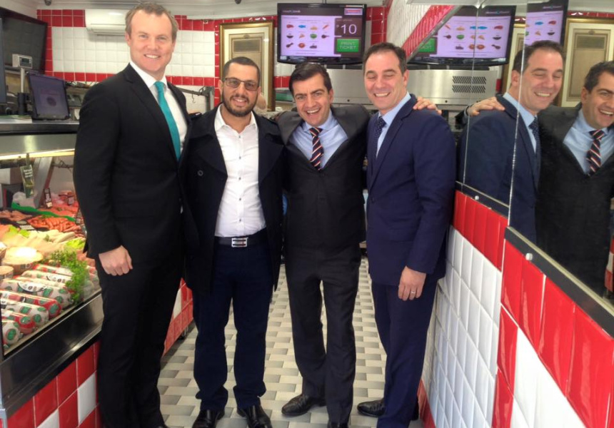 Sam Dastyari [centre] in a halal butcher (via Twitter)