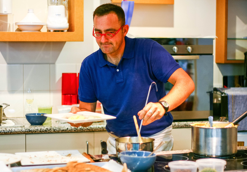 Emmanuel Mollois conducting a cooking class.