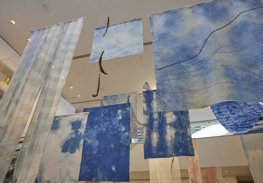 Judy Watson 'clouds and undercurrents' 2020–21 indigo, acrylic, natural pigments, embellishment on canvas, bunya leaves, nets, vinyl, sound, installation dimensions variable. Courtesy the artist and Milani Gallery, Meanjin (Brisbane) © the artist