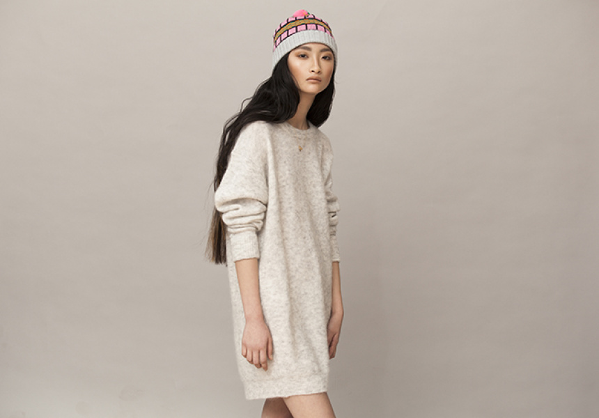 Beanie by ALL Knitwear from Dagmar Rousset. Dress by ACNE. Necklace by Petite Grand from INCU.