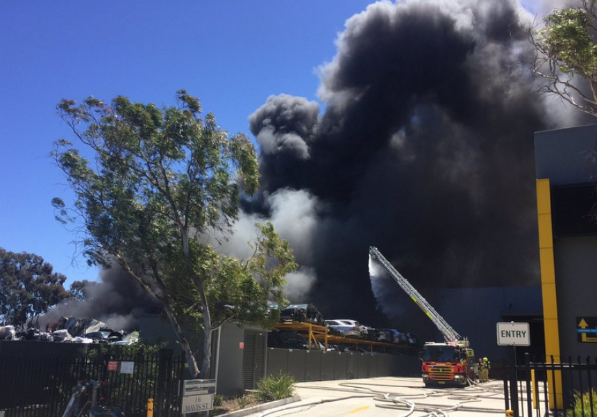 More than 100 firefighters battled the Revesby caryard blaze yesterday.