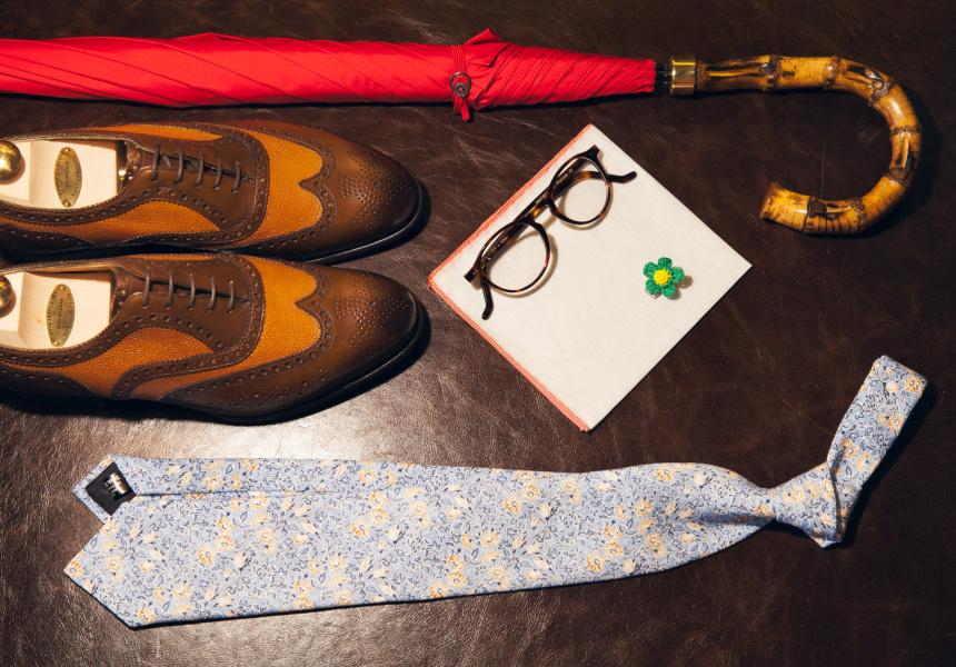 "The ""Mr Cad"" Look: Edward Green Falkirk in dark oak calf and almond country calf, Fox Umbrella with red canopy and whangee bamboo handle, Simonnot Godard white linen pocket square with orange edge, Tibi Tie knitted silk flower lapel pin, C.W. Dixey & Son Chartwell 03 tortoiseshell glasses, Tie Your Tie floral pattern linen tie"
