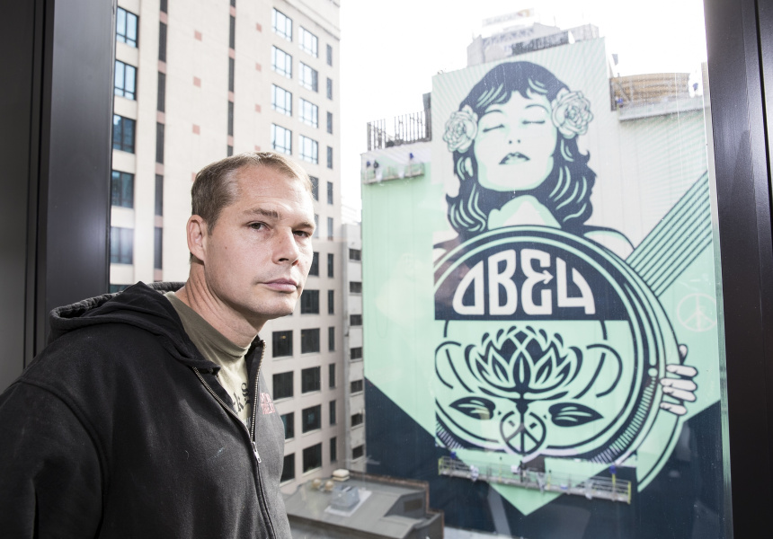 Shepard Fairey in front of his new mural in Sydney, Peace Waratah.