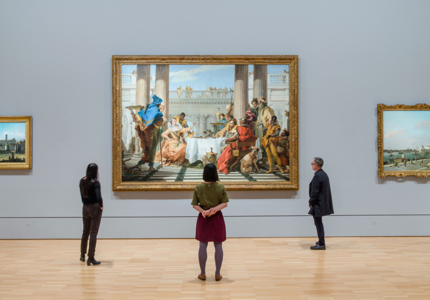 Visitors viewing Giambattista Tiepolo's The Banquet of Cleopatra (1743–44) at NGV International