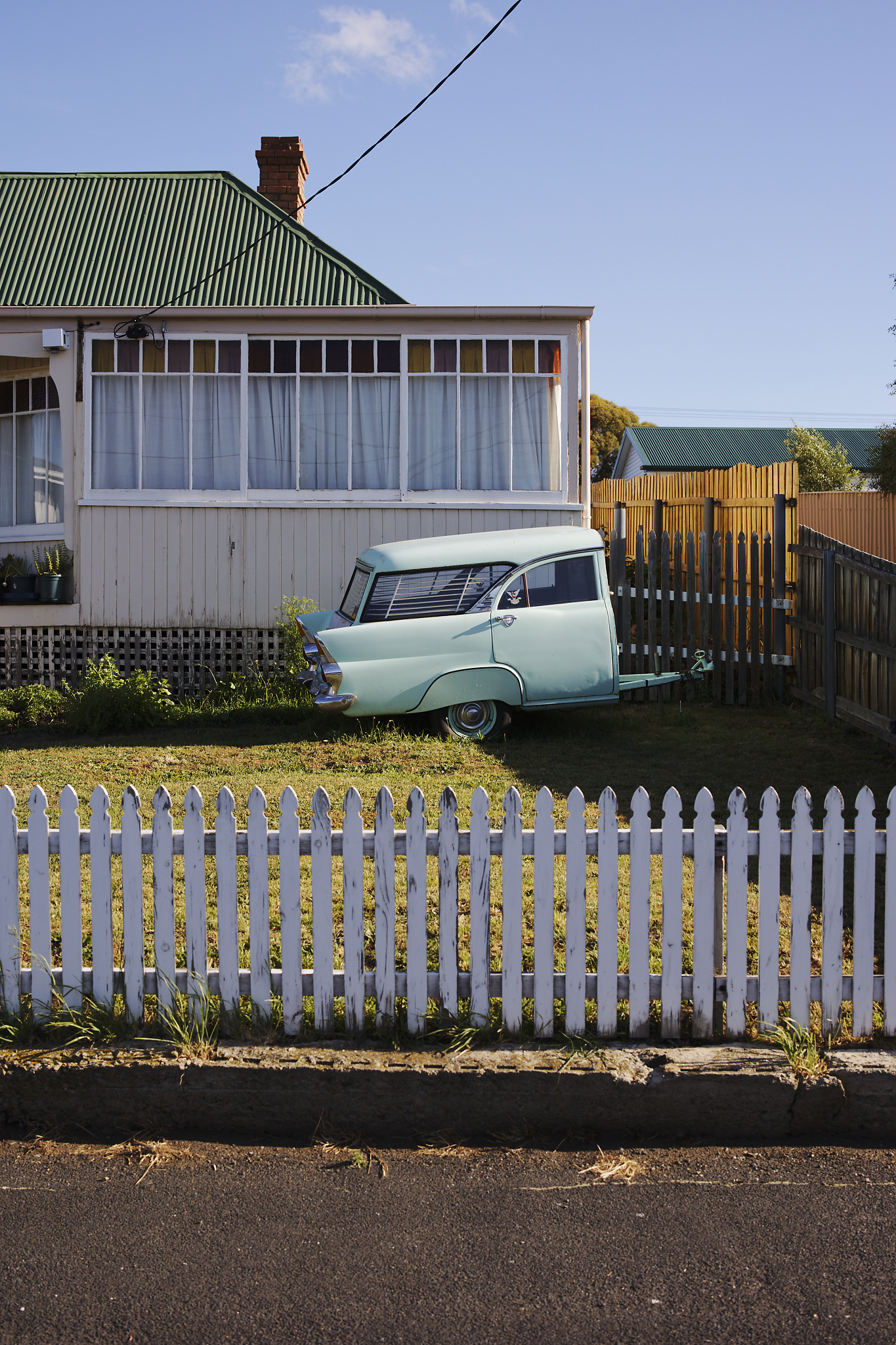 This image was a classic drive-by decision. If I don't stop to shoot, will I regret it? I decided I would. With the late afternoon sun diffused by haze, I was keen to see what shadow detail I could retrieve whilst keeping the colours true. I used the reflective qualities of the weatherboard siding to help capture the pastel shades and great tonal range in colour. It made for a crisp and spring-appropriate composition.   I like shooting high contrast situations, and the Canon EOS R6 and 50mm lens meant I could easily shoot highlights while still capturing the shadows. Using the wide-open RF 50mm f/1.2L USM lens also meant I could move quickly – helpful, as I was standing in the middle of the road.