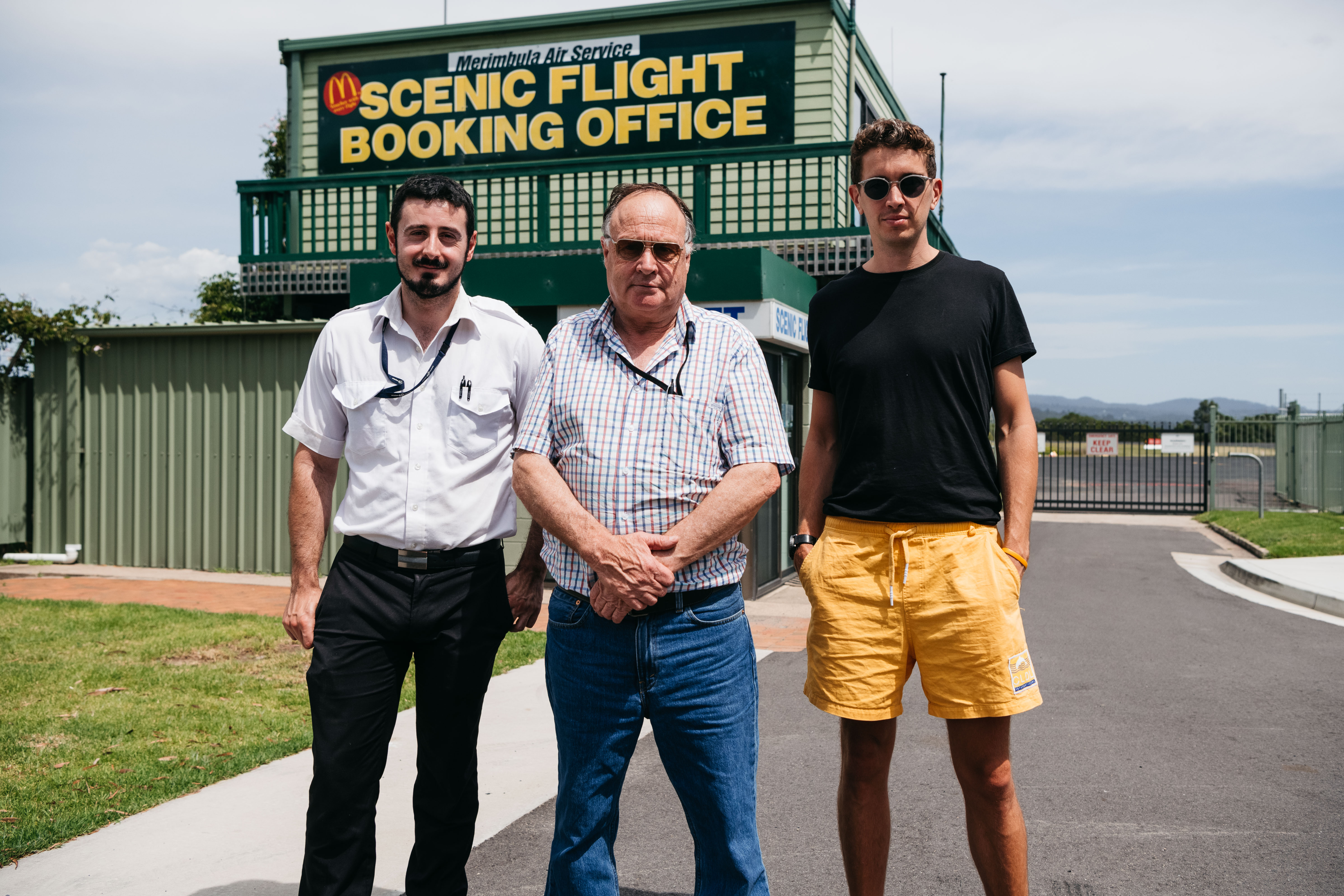 Hugo Gruzman (far right) at Merimbula Airport, where his pilot grandfather Laurie founded air freighting service Flight Facilities.