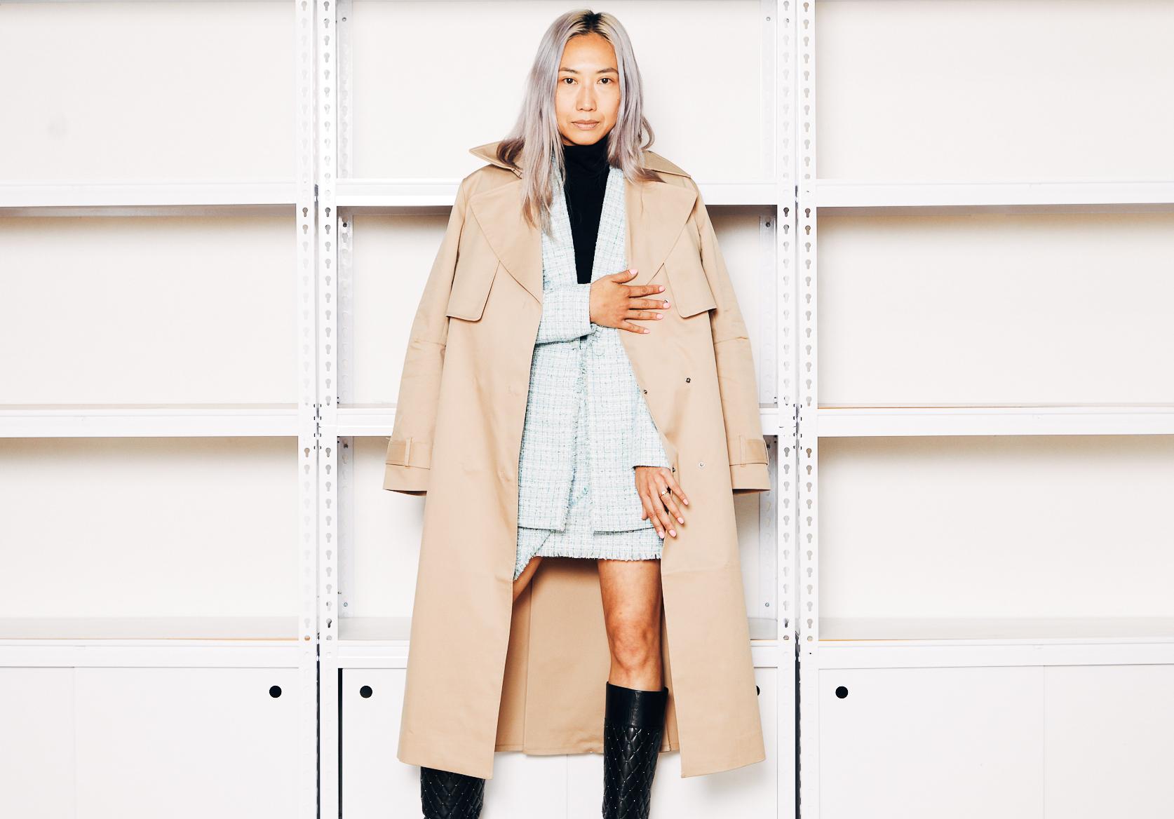 Jade Leung wears Saba trench coat, tweed suit and merino wool half-sleeve top. Boots stylist's own.